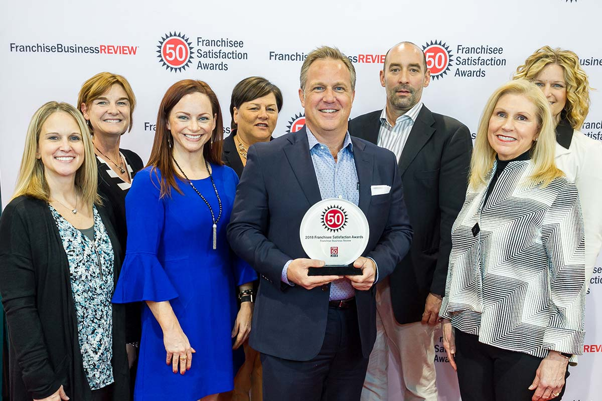 Home Instead leaders accept Franchise Business Review Franchisee Satisfaction Award